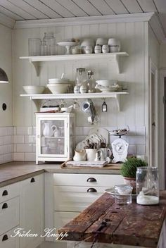 Reclaimed Wood / Added to a classic white kitchen.