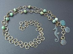 August challenge piece, Swellegant bronze with rust patina on B'Sue seahorse and shells, with turquoise beads.