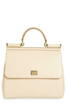 This Dolce&Gabbana satchel is the perfect mix of elegance and sophistication.