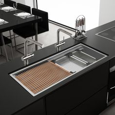 """Kitchen Sinks Remodeling Roma Workstation 2-Tiered Ledge 45"""" x 10"""" Undermount Kitchen Sink - Ruvati takes kitchen functionality to a whole new level with this 45″ long workstation sink that converts your kitchen sink to a full-fledged work space. The sink comes with an array of built-in accessories and the rim of the sink has a 3/4″ reveal on the front and back when installed. This forms the upper tier track for cutting boards and rollup rack. The lower tier forms a track for sliding the…"""