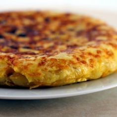 Spanish Tortilla. I grew up with these. This is the closest recipe I've seen to an authentic tortilla. My grandmother taught us to slice the potatoes very thinly. Delicious.