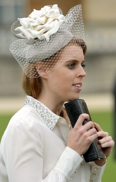 Princess Beatrice attends the first garden party of the season in the grounds of Buckingham Palace on May 21, 2014 in London, England.