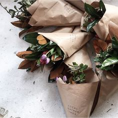 Paper-wrapped florals - anyone can do! I keep brown paper in the shed always - stamp your initial and toss in clippings from your garden. For a dinner party clip an herb bouquet!