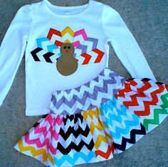 ***We may have long or short sleeve tees depending on the season. Please contact us for t-shirt availability. Give thanks! This adorable turkey is perfect for Thanksgiving. The turkey has cute multicolor chevron striped feathers, a tan corduroy body and button eyes. ONESIE SIZES: SHORT OR