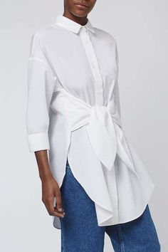 Walk the line between smart and chic in the oversized tie shirt by Boutique. Crafted in a rich cotton, it comes detailed with clean styling and contemporary details. Featuring a front tie and side splits, we love it styled with denim for off-beat cool. #Topshop