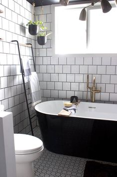 This modern bathroom renovation by Lindi and Russel from Love, Create & Celebrate provided the perfect combination of modern black and white contrast and fun elements like a vintage rug and Champagne Bronze faucet and shower head from Delta. Vintage Bathrooms, Modern Bathroom, Beautiful Bathrooms, 1920s Bathroom, Barn Bathroom, Cozy Bathroom, White Bathrooms, Bathroom Towels, Washroom