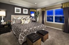 Rich, contrasting paint on two walls frames this warm and inviting master bedroom. The Frisco Model by Meritage Homes at The Preserve in Brighton, CO.