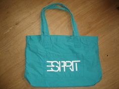 Espirit.  I had this bag in purple and I carried it everywhere with me!!!!  I would still use it if I still had it!!