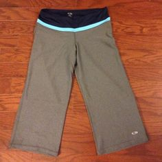 Champion capris Polyester spandex blend exercise capris in marled grey with blue banded waist. Size small but these run on the smaller side. Like new condition! These are Champion brand not Athleta which is only listed for better search purposes. Athleta Pants Capris