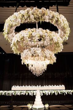 If the venue has a high ceiling - take advantage of it by having the florist create a chandelier full of flowers ~ Bride to Be Magazine Australia