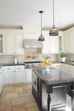 kitchen contemporary kitchen // Love the bright and airy feel the kitchen exudes. The grey marble countertops are balanced nicely with the stainless steel appliances and the sleet grey island