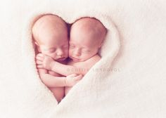 Beautiful heart newborn photo for twins. Gorgeous newborn photography by Captured by Carrie. #pinparty