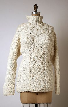 Jean Paul Gaultier, French, 1980s French Cotton Sweater Gaultier was a popular designer during the 80s and 90s. He often played with the concept of women's bodies in his designs. This design reflects the concepts he explored as well as the large chunky sweater style that was popular in the 80s.