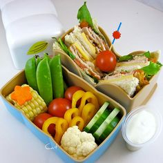 Not all bentos need to be decorated with cartoon characters. Here is a beautifully presented bento box which makes use of colour to appeal to younger eaters. :)