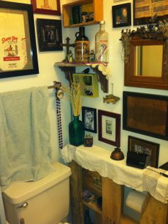 a bit of rustic decor in my hubby's tiny bathroom
