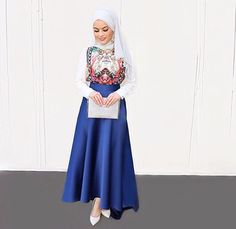 Pinterest: @eighthhorcruxx. Embroidered shirt with white sleeves, cobalt blue skirt, white hijab and white heels