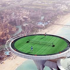 "Burj al Arab, Dubai. You can literally play Tennis on the top of this hotel?! I'd be terrified I'd fall off. However, it does remind me of the Wii game of ""sword fighting"""