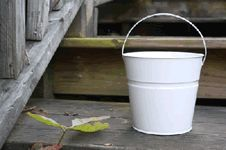 """White Metal Buckets - Bucket Outlet. Maybe a good option to go with white?  These are 12 for $43 which seems like a good deal. They are 6"""" tall."""