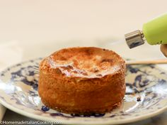 Using a kitchen blow torch to make brulee topping on butter cake