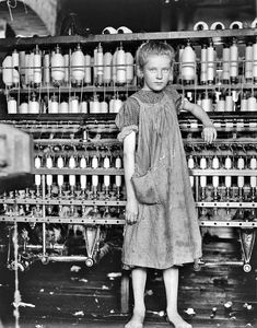 This photo is part of a collection from Lewis Hine, who documented child labor in the early 20th century.  This photos was a 12 year old working in cotton/textile.  Most of the children that worked in these mills had major health problem, sometimes causing death, from breathing in the lint that floated heavily in the air.
