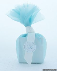 Blue Fabric-Wrapped Favor  This romantic box is swathed in organdy and finished with ribbon and a monogram sticker