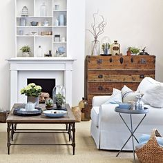 Country-style white living room White walls create a blank canvas for this cosy, country-style living room. The fireplace is the focalpoint of the room with quirky cubbyhole shelving above the mantle providing an area for display.  Read more at http://www.housetohome.co.uk/room-idea/picture/10-best-white-living-room-ideas#Rs644tJEGWiOkmjt.99