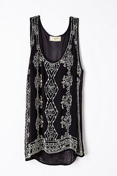 Glisten tunic / Anthropologie. Perfect to pair with a leather jacket.