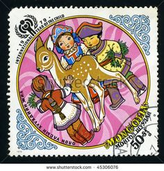 stock photo : MONGOLIA - CIRCA 1979: a postage stamp shows image of the international year of the child, baby with deer, circa 1979