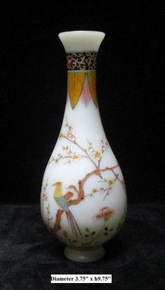 Peking glasses are made at a extremely high temperature (over 1000℃), that's why it has higher density and more beautiful color than regular glass.    This colorful vase is made of Peking glass and has birds & flowers hand painting on the body. It is one of the kind art works and worth of being collected.
