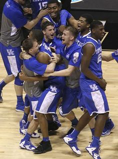 I'd say this is the beginning of the dog pile on Aaron Harrison. I'm celebrating with you guys!! Go Big Blue!!  March 30, 2014