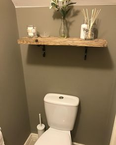 Under stairs toilet decor made shelf from scaffolding wood #understairs #smallbathroom #decor #shelfdecor #bathroom