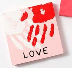 Show your love with this Handprint Valentine Canvas. Perfect for parents and grandparents for keepsakes. #valentines #heart #diyvalentines #kidscrafts #keepsake