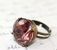 I love the colour of this ring, I have ear rings that would match this perfect!!!