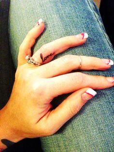 "My husbands handwriting ""love"" tattooed on my ring finger"