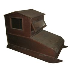 This superb recent barn find is indeed a rare piece of American folk art, a covered child's sled dating to the early 1900s. Quite possibly Amish or Mennonite, this unusual item was recently found in an old Tennessee barn.