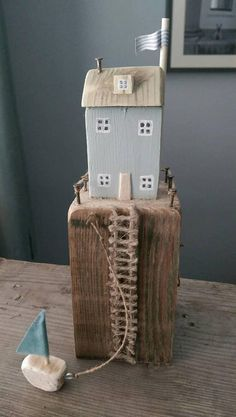 Created using only reclaimed materials This driftwood coastal cottage painted a soft duck egg blue sits high on a reclaimed vintage wood harbour. Small Wooden House, Wooden Cottage, Coastal Cottage, Wooden Houses, Scrap Wood Crafts, Wooden Crafts, Wooden Toys, Into The Woods, House In The Woods