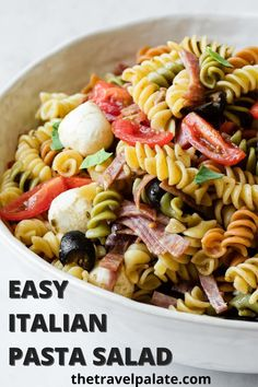 The Best Italian Pasta Salad has to be easy and delicious! This simple classic version is just that and made with salami, tomatoes, olives and mozzarella cheese and drizzled with pesto dressing. Served cold, it's the perfect summer dish.