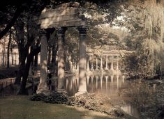 Vivid color photos of 1923 Paris, hub of artistry and progress.....A colonnade and lake in a garden. IMAGE: JULES GERVAIS-COURTELLEMONT/NATIONAL GEOGRAPHIC CREATIVE/CORBIS