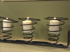 springs from an old chair repurposed into votive holder (or with taller glass - vases)