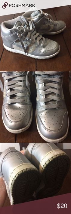 Sparkly nikes Woman's size 8 sparkly silver nikes. These are in good structurally, they do have some scuffs and marks. Soles measure 10 3/4 inches. Nike Shoes Sneakers