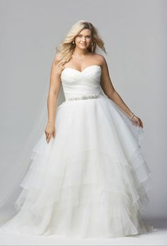 "Brides: Wtoo. Style 12011, ""Cecilia"" ivory textured organza strapless sweetheart neckline tiered handkerchief skirt with alternating layers or textured organza, $1,300, Wtoo"