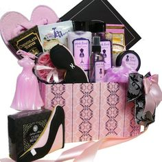 """This luxurious gift is """"Dressed to Impress"""" with stylish spa products and decadent gourmet treats! Pamper your diva with Lightly Scented Floral Bath and Body Shower Gel, Moisturizing Body Lotion, Exfoliating Body Scrub, Soothing Bath Crystals, Pink Rose Shaped Soaps, and Tealight Candles to make her personal spa bath time extra special. Indulge her sense of good taste with Cinnamon Sugar Cookies, decadent Chocolate Espesso Cake, Enli-Tea-Ments English Breakfast Tea, and more. Art of…"""