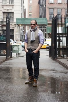 FEATURED ITEMS: Dark blue jeans by AG Purple cotton check shirt by Michael Andrews Bespoke Tweed waistcoat by Michael Andrews Bespoke Striped wool scarf by Tino Cosma Dark brown duck boots by L.L. Bean Sunglasses by Tom Ford.