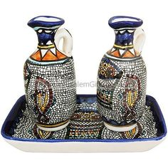 Beautiful set including hand painted Armenian ceramic tray and pair of jugs.  Can be used in either ministy with water and wine or at the dinner table with oil and vinegar.  Tray size: 6 x 4 x 1 inch high. Jug size: 4.5 inches high Microwave and Dishwasher safe Lead Free