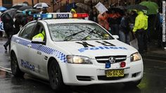 Four men, and a teenage boy have been arrested for the gang-rape of a 16-year-old girl at a Sydney house party earlier in the year, New South Wales police say.