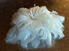 Bridal hair flower made from feathers available at Styles by M