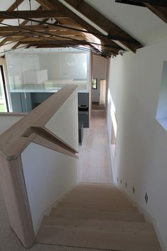 recessed wood-lined handrail // Contemporary Staircase by JAMIE FALLA ARCHITECTURE