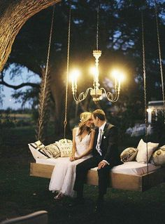 Outdoor bed swing with chandelier overhead