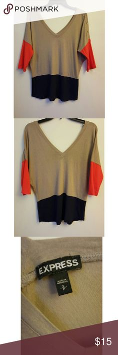 Express oversized low plunge neck line tee This is a comfy oversized tee in size small. The of the tee are colors are tan, orange and navy blue. Show off your shoulders, chest and back with its low plunge wide shoulder neck line. Right shoulder embellished with buttons. Express Tops Tees - Short Sleeve