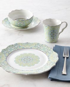 """Fine china. Floral medallion decoration with scalloped purple rims. Dishwasher and microwave safe. 16-piece service includes four 11.5""""Dia. dinner plates, four 9""""Dia. salad plates, four 5.5""""Dia. 24-oz"""